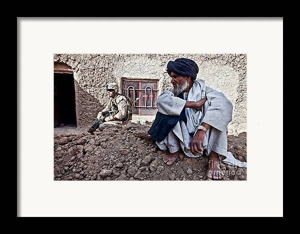 Middle East Framed Print featuring the photograph A Soldier Collects Information by Stocktrek Images