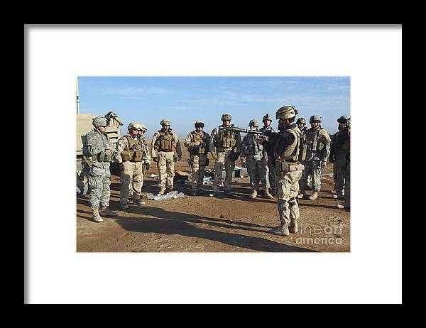 Color Image Framed Print featuring the photograph A Soldier Teaches How To Properly by Stocktrek Images