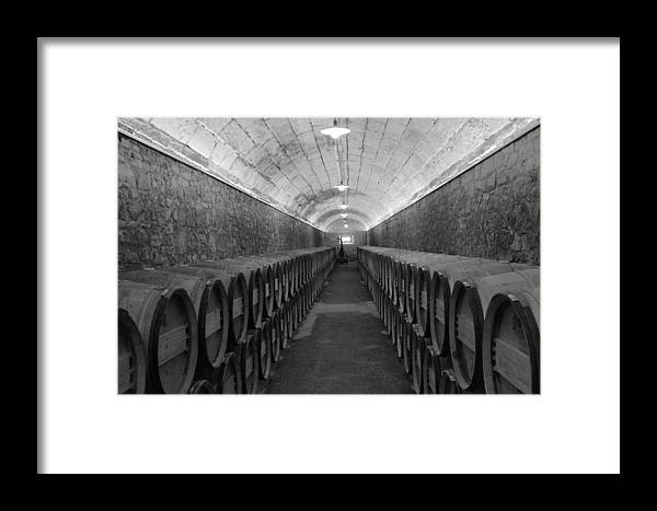 Barrels Framed Print featuring the photograph A Spanish Cellar by John Stuart Webbstock