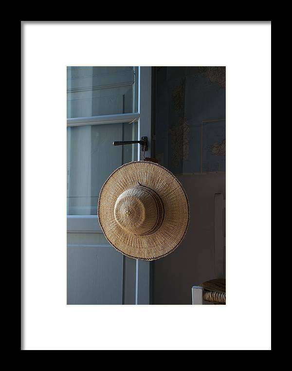 Indoors Framed Print featuring the photograph A Sun Hat Hangs On The Door Of A Tuscan by Heather Perry