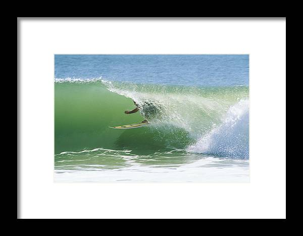 Outdoors Framed Print featuring the photograph A Surfer Shoots The Curl by Raymond Gehman