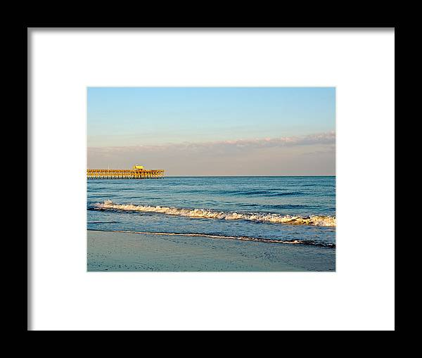 Apache Pier Framed Print featuring the photograph A View From The Beach by Eve Spring
