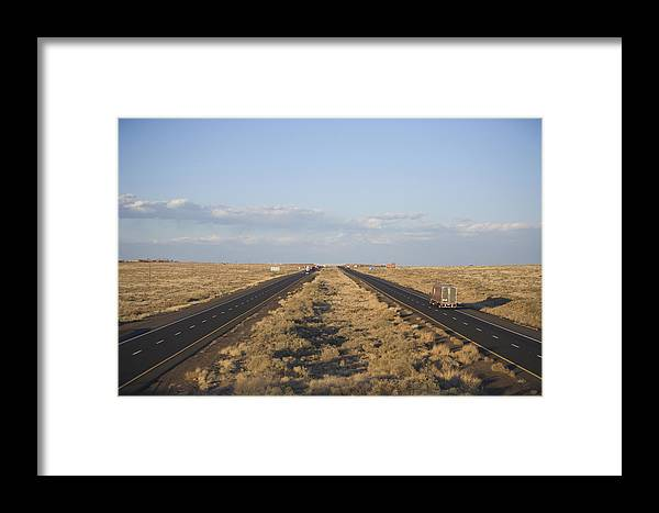 Interstate Framed Print featuring the photograph A View Of Interstate 40, Arizona Usa by John Burcham