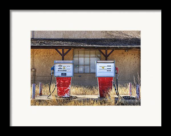 Abandoned Framed Print featuring the photograph Abandoned Gas Pumps And Station by Dave & Les Jacobs