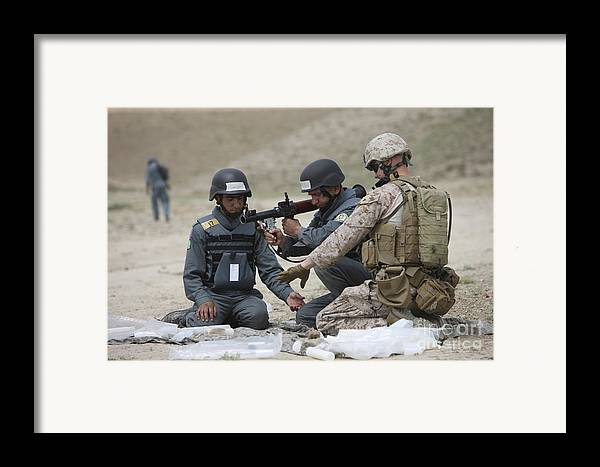 Soldier Framed Print featuring the photograph Afghan Police Students Assemble A Rpg-7 by Terry Moore