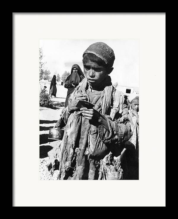 History Framed Print featuring the photograph Afghan Youngster In A Unicef Feeding by Everett