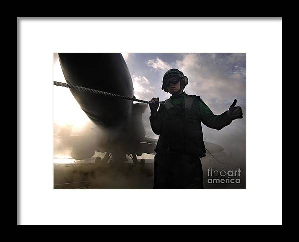 Horizontal Framed Print featuring the photograph Airman Holds Up The Safety Shot Line by Stocktrek Images