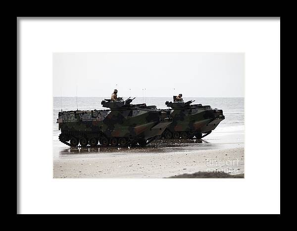 Men Framed Print featuring the photograph Amphibious Assault Vehicles Land Ashore by Stocktrek Images