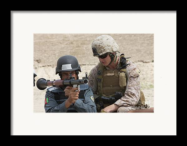 Soldier Framed Print featuring the photograph An Afghan Police Student Aiming A Rpg-7 by Terry Moore