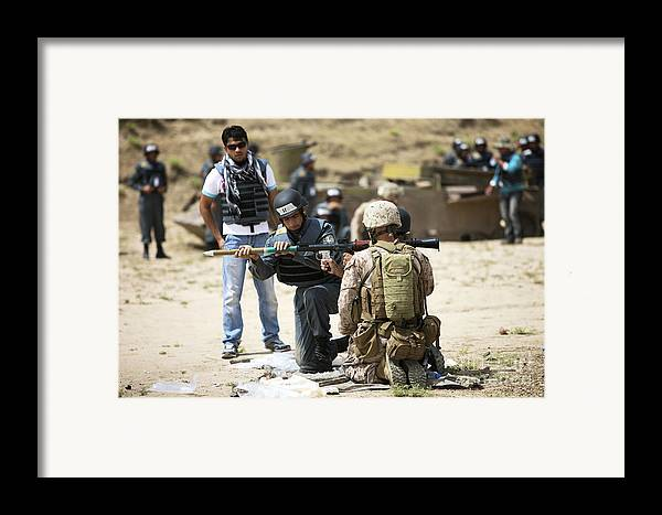 Kunduz Framed Print featuring the photograph An Afghan Police Student Loads A Rpg-7 by Terry Moore
