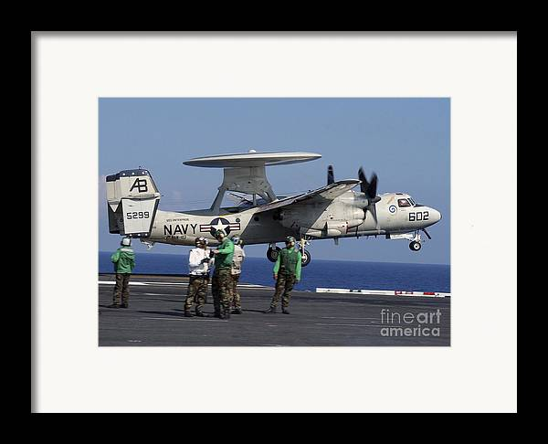 Squadron Framed Print featuring the photograph An E-2c Hawkeye Launches From Aboard by Stocktrek Images