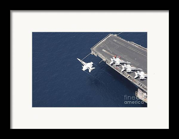 Horizontal Framed Print featuring the photograph An Fa-18 Hornet Flys Over Aircraft by Stocktrek Images