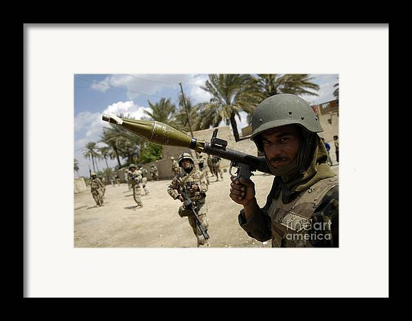 Carrying Framed Print featuring the photograph An Iraqi Army Soldier Provides Security by Stocktrek Images