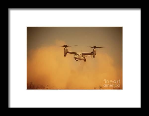 Dust Framed Print featuring the photograph An Mv-22 Osprey Aircraft Blows Dust by Stocktrek Images