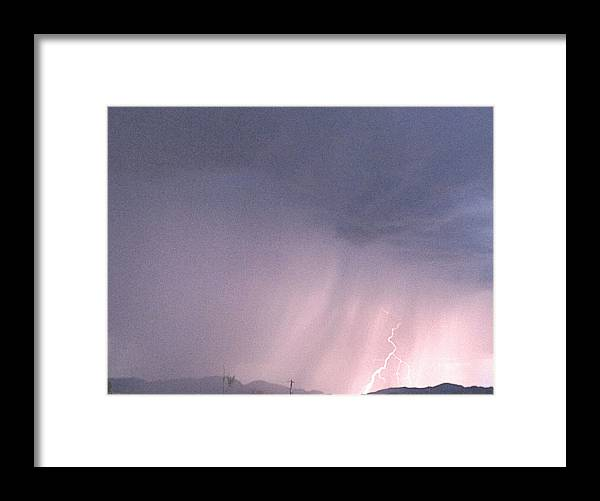 Rain Framed Print featuring the photograph And The Rains Came by Kathleen Nash