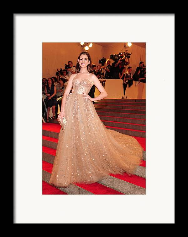 Anne Hathaway Framed Print featuring the photograph Anne Hathaway Wearing A Valentino Gown by Everett