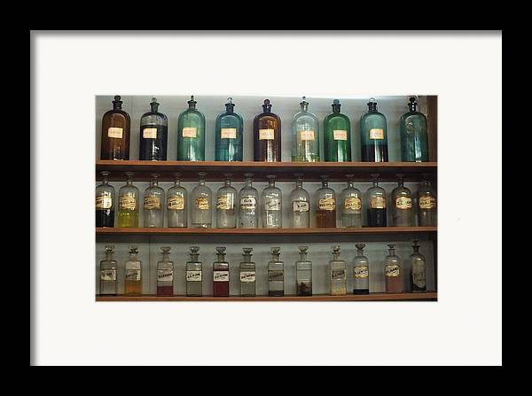 Antique Bottles Framed Print featuring the photograph Apocethary Jars by Anna Villarreal Garbis