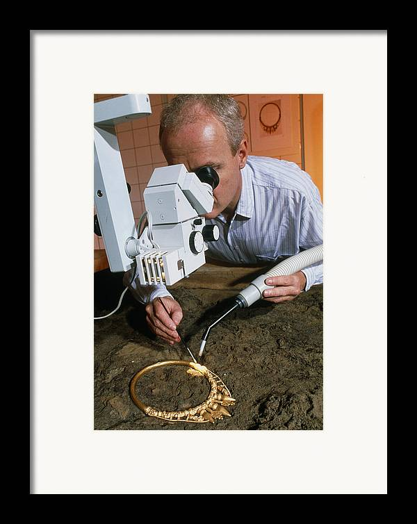 Celtic Necklace Framed Print featuring the photograph Archaeologist Cleaning A Golden Celtic Necklace by Volker Steger