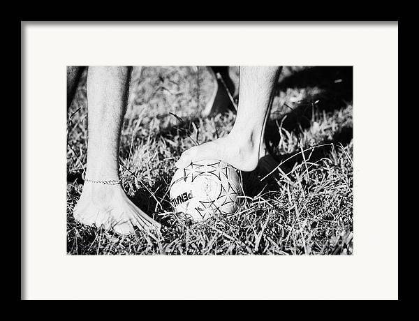 Men Framed Print featuring the photograph Argentinian Hispanic Men Start A Football Game Barefoot In The Park On Grass by Joe Fox