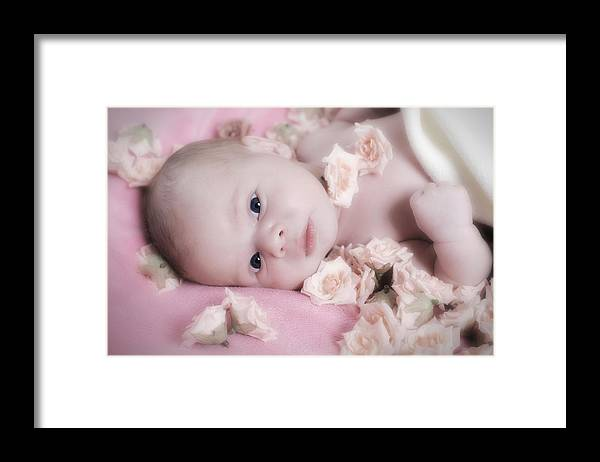Adorable Framed Print featuring the photograph Baby in bed of roses by Waldek Dabrowski