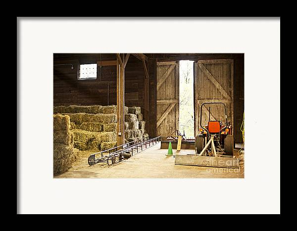 Barn Framed Print featuring the photograph Barn With Hay Bales And Farm Equipment by Elena Elisseeva