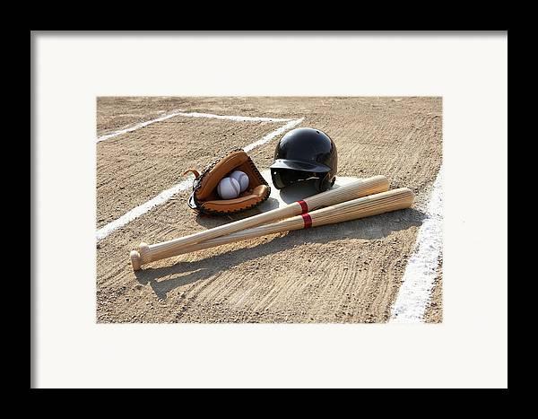 Horizontal Framed Print featuring the photograph Baseball Glove, Balls, Bats And Baseball Helmet At Home Plate by Thomas Northcut