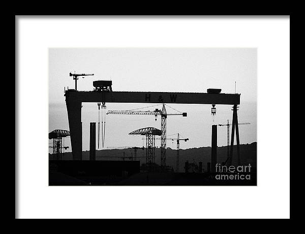 Harland Framed Print featuring the photograph Belfast Shipyard Cranes Skyline Evening Harland Wolff by Joe Fox