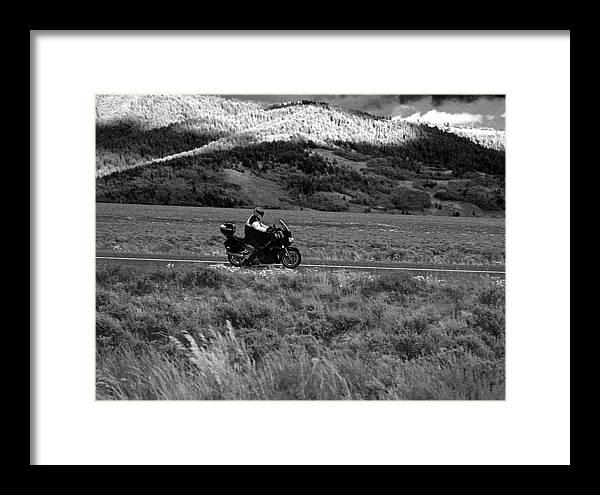 Yellowstone; National Park; Landscape; Black; White; Cloud; Overcast; Storm; Thunder; Jackson Hole; Montana; Trees; Bushes; Shade; Shadow; Sunshine; Sunlight; Light; Brightness; Daylight; Light Of Day; Weeds; Grass; Motorcycle; Motorbike; Bike; Street Bike; Helmet; Tire; Honda; Suzuki; Kawasaki; Yamaha; Rims; Jacket; Luggage; Fairing; Transportation; Ride; Road; Bike Run Framed Print featuring the photograph Bike Run Through Yellowstone by D L McDowell-Hiss