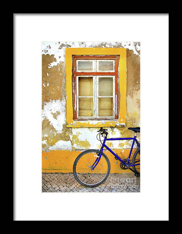 Aged Framed Print featuring the photograph Bike Window by Carlos Caetano