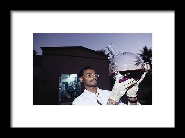 Biocon Framed Print featuring the photograph Bioscientist Holding Flask by Volker Steger
