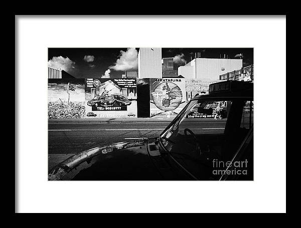 Murals Framed Print featuring the photograph Black Taxi Falls Road Belfast by Joe Fox