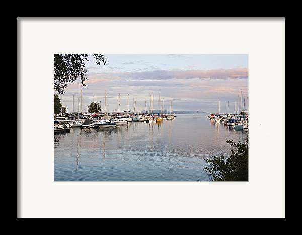 Tranquil Framed Print featuring the photograph Boats In The Harbour At Sunset Thunder by Susan Dykstra