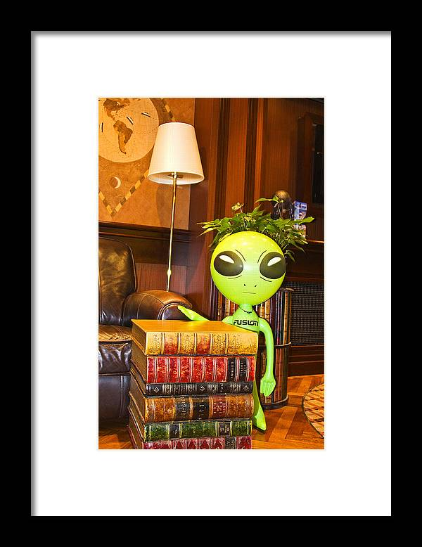 Alien Framed Print featuring the photograph Bookworm Alien by Richard Henne