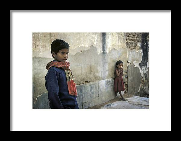 Book Framed Print featuring the photograph Boy And Girl by Rudy Van Acker