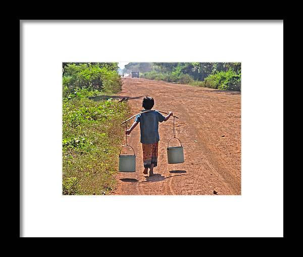 Human Framed Print featuring the photograph Boy Carrying Drinking Water by Bjorn Svensson