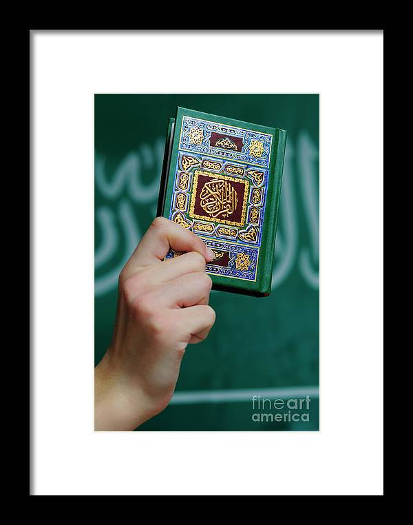 People Framed Print featuring the photograph Boy's Hand Holding Koran by Sami Sarkis