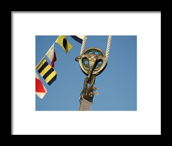 Brass Block Framed Print featuring the photograph Brass Block With Flags by Kym Backland