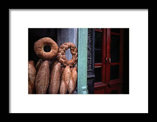 New York City Framed Print featuring the photograph Bread Is Displayed In A Store Window by Raymond Gehman
