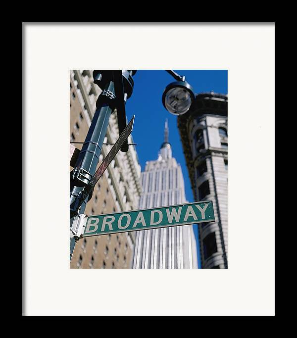Architecture Framed Print featuring the photograph Broadway Sign And Empire State Building by Axiom Photographic
