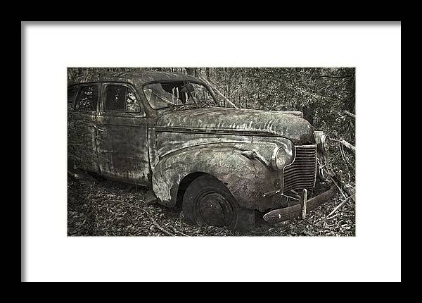 Rustbuckets Framed Print featuring the photograph Camouflage Classic Car by John Stephens