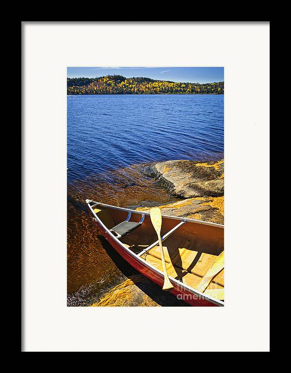 Canoe Framed Print featuring the photograph Canoe On Shore by Elena Elisseeva