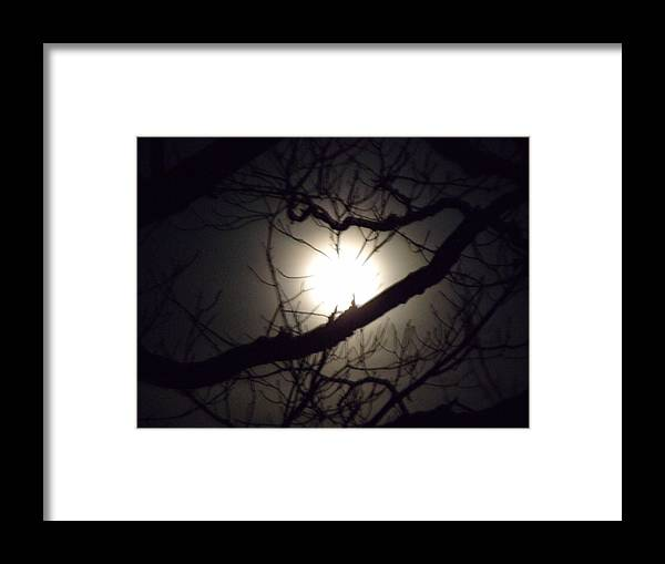 Moon Framed Print featuring the photograph Captured By Your Heart by Dennis Comins