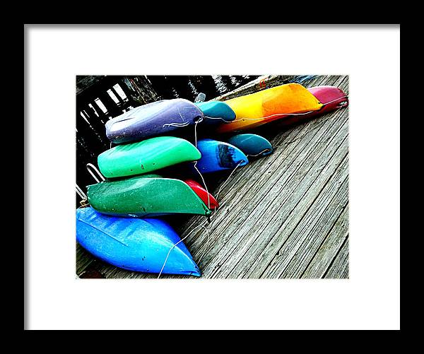 Canoes Framed Print featuring the photograph Carefully Stacked by Kevin D Davis