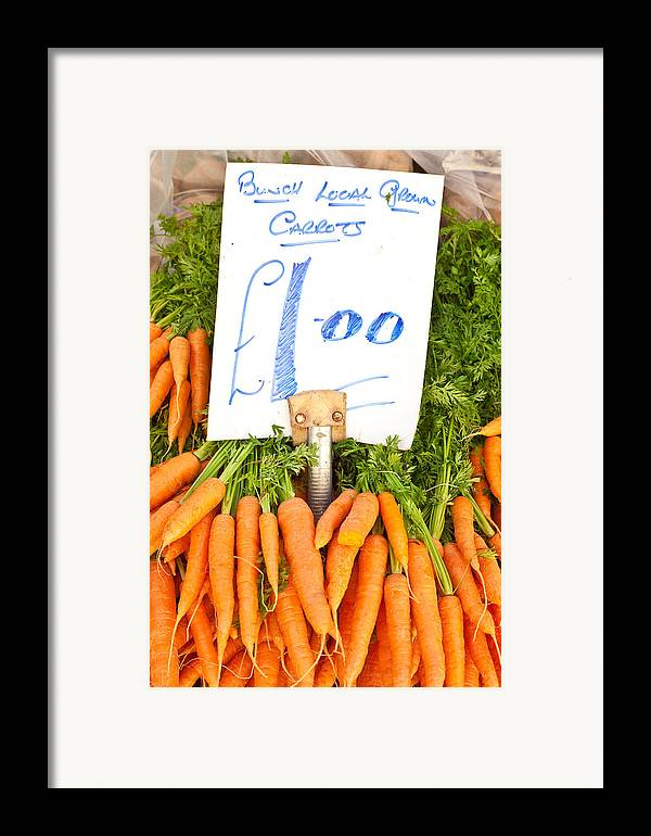 Carrots Framed Print featuring the photograph Carrots by Tom Gowanlock