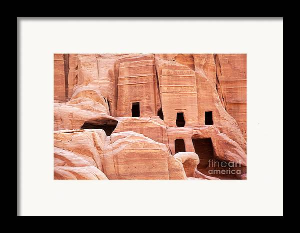 Ancient Framed Print featuring the photograph Cave Dwellings Petra. by Jane Rix