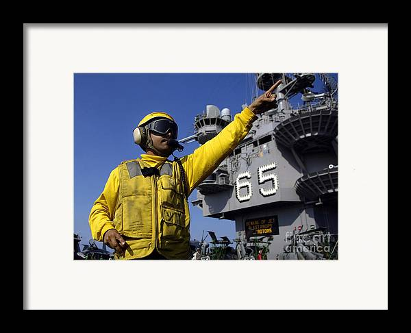 Color Image Framed Print featuring the photograph Chief Aviation Boatswains Mate Directs by Stocktrek Images