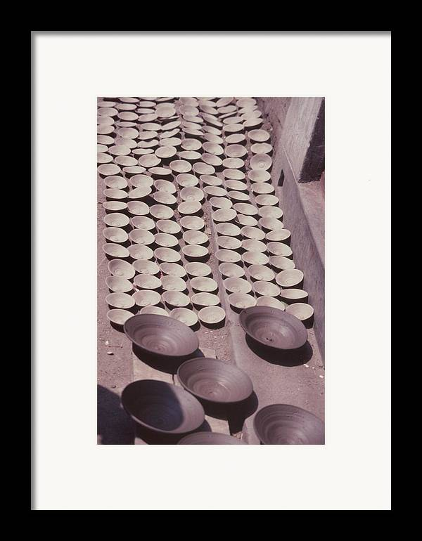 Hand-thrown Pottery Framed Print featuring the photograph Clay Yogurt Cups Drying In The Sun by David Sherman