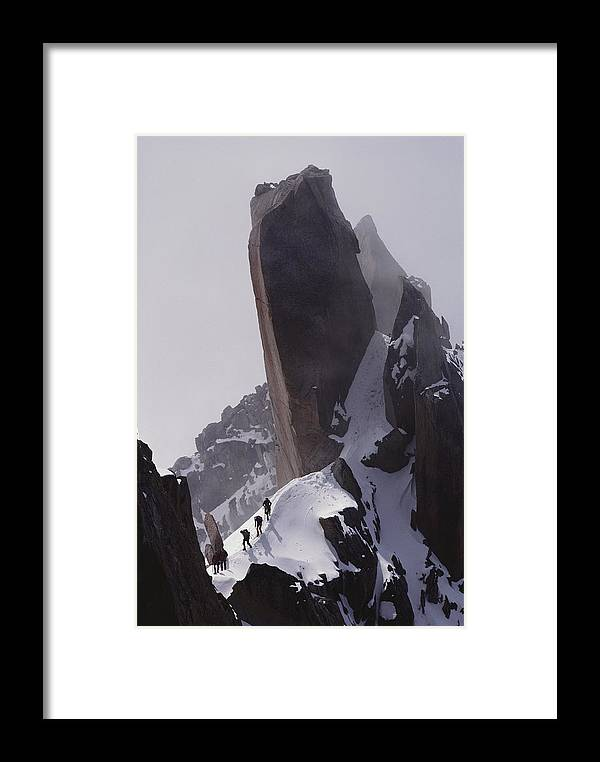 Alps Framed Print featuring the photograph Climbers Move Carefully Across Steep by Paul Chesley