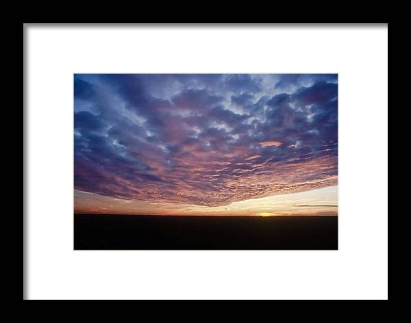 Clouds Framed Print featuring the photograph Clouds At Sunrise by Patrick M Lynch