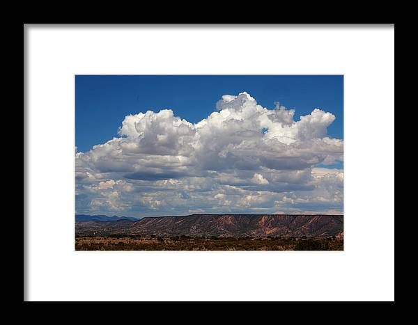 Clouds Framed Print featuring the photograph Clouds Over A Mesa by Paul M Littman
